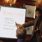 Businessman explaining retreat agenda