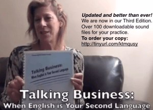 Jayne Latz holding Talking Business